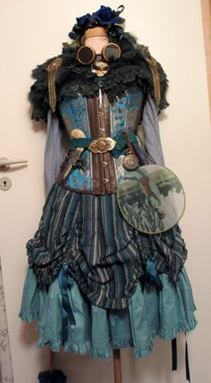 Turquoise steampunk  Skirt: Bodyline L120 Pocket watch: Bodyline Corset, goggles and sunglasses: eBay Crystal necklace: Selfmade Everything else is thrifted