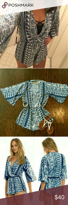 Elan Romper Large - blue and white Greek paisley I bought these on Posh because I loved them but they're a little short on me! Gorgeous blue and white paisley Greek-style print is perfect for a Sunday Funday.  Would fit up to a smaller 12 really well.   They're Elan  (a beachy brand sold a lot at Diane's Swimwear shops) and listed as Free People for more exposure.  Thanks for looking!!! Free People Dresses Mini
