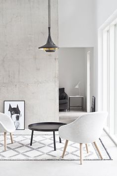 Black, white and concrete living room. Minimal Nordic design with a few strong black accents. #nordicinspiration  #nordicliving #interiorinspiration