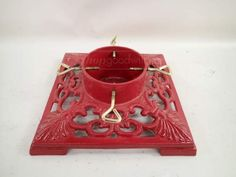 shopgoodwill.com: Red Enamel Cast Iron Christmas Tree Stand