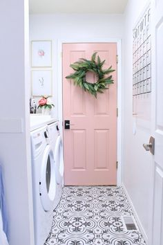 If this isn't a dream laundry room I don't know what it is. Side-by-side washer and dryer with folding counter, cement tile floors, and a light pink door. Wouldn't you love doing laundry in this laundry room? How to have a stylish laundry room. Laundry Room Organization, Laundry Room Design, Laundry Decor, Laundry Detergent Storage, Laundry Hacks, Painted Interior Doors, Painted Doors, Painted Tiles, Painted Bedroom Doors