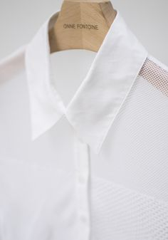 Cirina is a shirt in French lace from Calais that is chic and modern thanks its geometrical design, swallow cuffs and cufflinks.