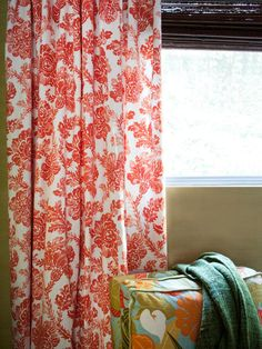 To give the children's bedroom pizzazz that's colorful and bold enough for kids, but chic and mature enough for parents, the windows were dressed with orange-and-white-toned botanical print draperies. Paired with woven wood blinds, the window coverings add privacy and filter out the strong California sun.