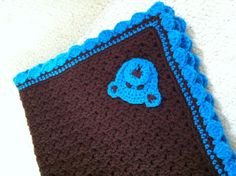 Matching crochet baby blanket with bear motif.