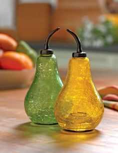 BEAUTIFUL Pear Fruit Fly Traps!!! Wow, I have to get one of these! The fruit flies are lured into the little spout and get trapped. Love the Sparkling crackle glass <3