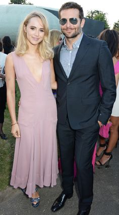 So happy: Bradley Cooper and Suki Waterhouse look smitten as they arrive at the Serpentine for the annual Serpentine Gallery Summer Party in Hyde Park on Tuesday Celebrity Look, Celebrity Couples, Most Stylish Men, Suki Waterhouse, Fashion Couple, Bradley Cooper, Bridesmaid Dresses, Wedding Dresses, Party Dresses