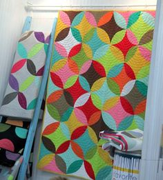 KAE says: Love those curves and the bright colors. Looks like off-centered spiral quilting which is awesome.