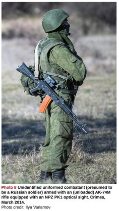 "C2 - Armament Research Services (ARES), Nov, 2014: ""Raising Red Flags: An Examination of Arms & Munitions in the Ongoing Conflict in Ukraine, 2014″, by Jonathan Ferguson & N.R. Jenzen-Jones. Unidentified uniformed combatant (presumed to be a Russian soldier) armed with an (unloaded) AK-74M rifle equipped with an NPZ PK1 optical sight. Crimea, March 2014."