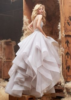 Dori Alabaster tulle bridal gown with halter high neck alabaster and crystal bodice, full horse hair flounced skirt and chapel train.
