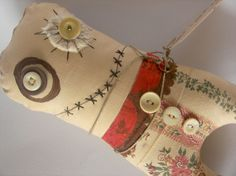 I like the use of random materials. Gives me an idea of what to do with my scraps and odd leftover bits and pieces.