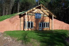 A seamlessly blended contemporary home built into the ground, with a full earthen roof Earth Sheltered Homes, Sheltered Housing, Underground Living, Underground Homes, Earth Homes, Earthship, Custom Homes, Building A House, House Plans