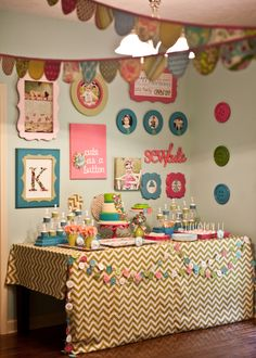 This is a little girls 1st birthday but I love the button garlands across the front of the table - would love to make these!