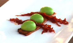 """Pea """"gnocchi"""" served with homemade bacon and sweet and sour caramelized shallots."""