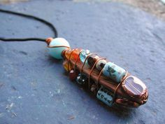 Wire wrapped wood, glass and Chinese ceramic pendant