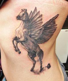 Pegasus style horse tattoo by Wojciech Taczala