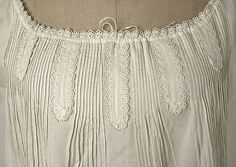 Detail of chemise  Date: ca. 1862 Culture: American Medium: cotton Dimensions: [no dimensions available] Credit Line: Gift of Mr. Edwin J. Gutman, 1944 Accession Number: C.I.44.93.4