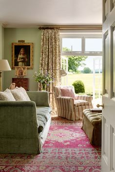 New fabrics in the drawing room include 'Stypes' on the armchair and 'Toile Chevron' on the sofa, both by Claremont; the curtains are 'Dandelion Clock' by Robert Kime