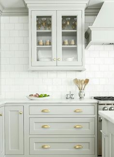 Drawer cup pulls: 2 per drawer; centered vertically on drawer Door knobs: offset from top of door