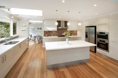 white kitchen with hardwood floors - Google Search