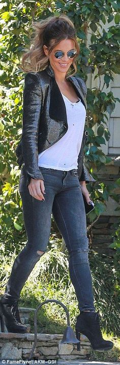 All smiles: Beckinsale looked cool and relaxed wearing ripped skinny jeans and a distressed white tee paired with a leather jacket and boots