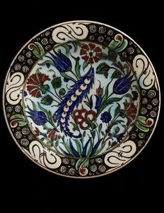 Bowl | Made in Florence, Italy, ca. 1892 | Ulisse Cantagalli (maker) | Bowl of tin-glazed earthenware. White ground painted in colours with leaves and flowers in Iznik style | In 1878 Ulisse Cantagalli inherited a factory in Florence and began to trade as Manifattura Figli di Giuseppe Cantagalli. His main production was of copies of Italian maiolica, but also of other European and Middle Eastern ceramics | VA Museum, London
