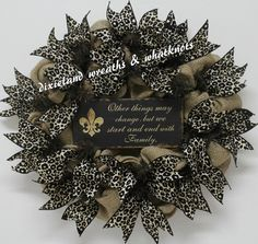 OTHER THINGS MAY CHANGE BUT WE START AND END WITH FAMILY - No truer words were ever spoken. This wreath is based on a 20 brown work wreath with burlap. The wooden sign measures 10 x 4.5. The 2.5 animal print ribbon is wired and may be adjusted as desired. No Hot Glue used!! All items are attached. Thanks for stopping by and have a blessed day.