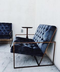 Blue velvet and edgy metal sofa
