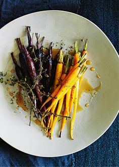 Honey, Lemon, Thyme Carrots 500g heirloom carrots, peeled and trimmed 2 tablespoons extra virgin olive oil mixed with 2 drops each of thyme an lemon essential oil ¼ cup (60ml) honey 1 tablespoon lemon juice 6 sprigs lemon thyme sea salt and cracked black pepper Preheat oven to 200°C (400°F). Place the carrots on a large baking tray with the oil, honey, lemon juice, thyme, salt and pepper and toss to combine. Roast for 30 minutes or until the carrots are tender. Serves 2