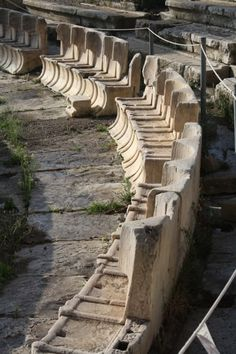 A row of the special stone seats from the front rows of the Theatre of Dionysos, on the slopes of the acropolis of Athens. Second half of the century BCE. The theatre was orginally constructed in. Theatre Architecture, Greece Architecture, Ancient Greek Architecture, Gothic Architecture, Ancient Ruins, Ancient Rome, Ancient Greece, Ancient History, Mayan Ruins
