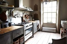 Lovely rustic kitchen. Great countertops and open shelving.  Michael kitchen