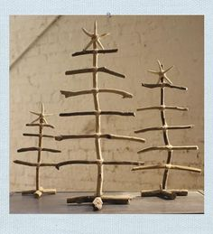 Driftwood Christmas Trees. Our Driftwood Trees are hand-crafted from natural found driftwood and bound together using nubby twine. Adorn with lights, ornaments or admire the trees for their simple natural beauty. Natural finger starfish tree topper included. Each will be unique by nature.