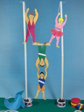 Trapeze Craft project: Printable patterns for making 3D circus trapeze performers and instructions for making a trapeze. Put these together with other crafts from the Under the Bigtop craft series to make a paper circus.
