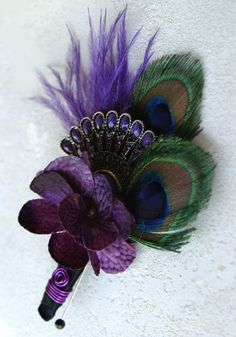 Purple Peacock Wedding Boutonnierre.... SO FAR MY FAVORITE BOUTONNIERE!!! Only thing I would change would be the feathers to the purple peacock feathers, but they've made it look so perfect with the purple accents here ;) ;)
