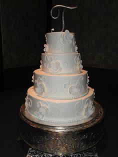 Chic wedding cakes with soft floral designs.  Cakes By Mindy At Receptions www.receptionsinc.com/weddings/cakes