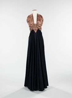 """From the Arabic"" Designer: Elizabeth Hawes (American, Ridgewood, New Jersey 1903–1971 New York) Date: fall/winter 1939 Culture: American Medium: silk, metal, wool Dimensions: Length at CB (a): 20 in. (50.8 cm) Length at CB (b): 61 in. (154.9 cm)"