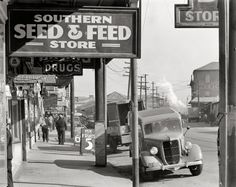 "December 1935. ""Waterfront in New Orleans. French market sidewalk scene."" Large-format nitrate negative by Walker Evans for the FSA."