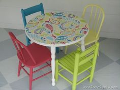 the finish on our little flower table could use an update.  I like this idea and our little chairs need new paint too.