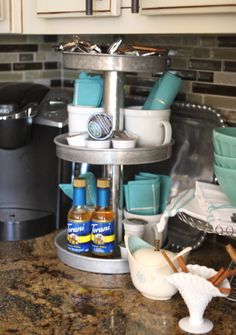 A three tiered stand, made with items from Goodwill, used to hold items for a coffee station