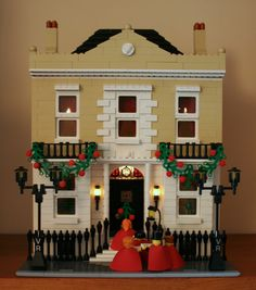 Good idea for Christmas decorations Christmas House: A LEGO® creation by Mandy… Lego Christmas Village, Lego Winter Village, Lego Village, Lego Gingerbread House, Gingerbread Christmas Decor, Christmas Decorations, Minecraft, Lego Club, Amazing Lego Creations