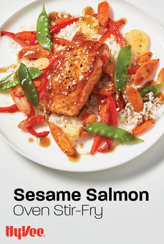 Easy salmon recipes ... we can't get enough of them. This one comes together on a sheet pan with all the yummy Asian flavors of a stir-fry. #EasyRecipe #EasySalmonRecipe #Salmon #EasyDinner