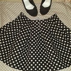 Polka dot skirt Made of polyester and spandex. medium size polka dot skirt. Thick scuba type material. In great condition. 17 inches long Skirts