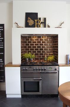 Look! A Kitchen Stove Designed Into a Chimney — With the Mantel Intact Kitchen Stove Design, New Kitchen Cabinets, Home Decor Kitchen, Interior Design Kitchen, Kitchen Appliances, Kitchen Ideas, Apartment Kitchen, Rustic Kitchen, Navy Kitchen