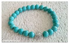 Check out this item in my Etsy shop https://www.etsy.com/uk/listing/249461926/blue-turquoise-howlite-beaded-bracelet