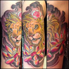 Lion and flower tattoo by Ben Gun