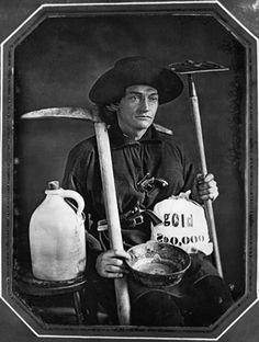 George W. Northrup, from Minnesota, posing with the tools of a gold miner, even down to the bag of gold. This is a daguerrotype photo from 1860.