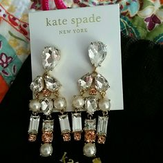 Kate Spade Chandelier Earrings NWT comes w/bag These GORGEOUS Kate Spade Earrings have diamond color copper color diamonds and pearls are very warm in color and are brand original cost was 128.00 dropping down to half 50 percent price is firm don't wait to long you won't be disappointed Guess what they also come with the bag thank you for looking Kate Spade  Jewelry Earrings
