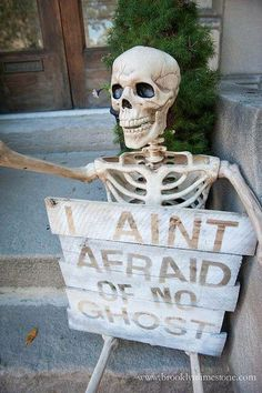Definitely need this skeleton with sign on our porch or yard