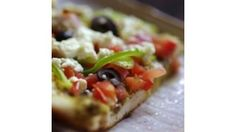 Top a prepared pizza crust with pesto, your favorite veggies and feta cheese and you've got a great, quick and easy meal.