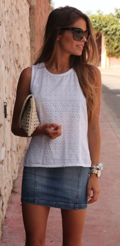 love the simplicity, and the sweet eyelet combined with the short skirt + studded clutch.