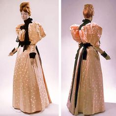 Pink satin dress w/woven floral design, ca. 1893-96. Bodice has high neck of black velvet w/2 velvet rosettes attached to back; front has flat side panels and poofed center panel, gathered at waist & yoke; center panel fastens to bodice underneath left side panel w/hooks & thread eyes, at shoulder & collar. Gored skirt w/black velvet band at waist; attaches to bodice w/hooks & eyes. All lined in pink taffeta. Smithsonian American History Museum